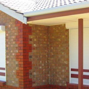 Brown Brick Structure with White Roller Shutters - Aus-Secure